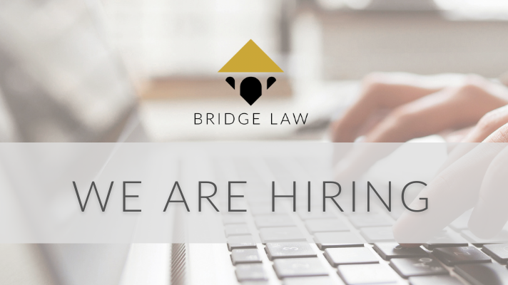 """Bridge Law blog header image of person typing with text saying """"We are hiring"""""""